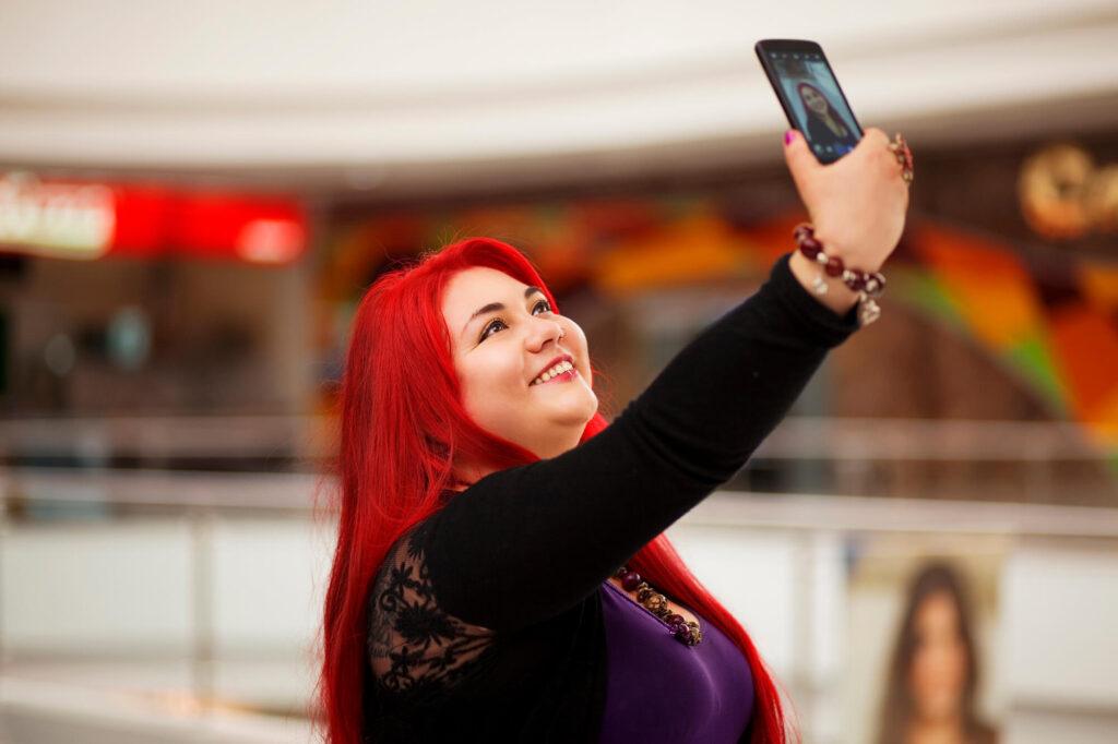 big beautiful woman taking selfie